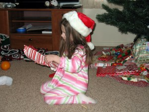 Anna trying to decide if this present is to her or from her.